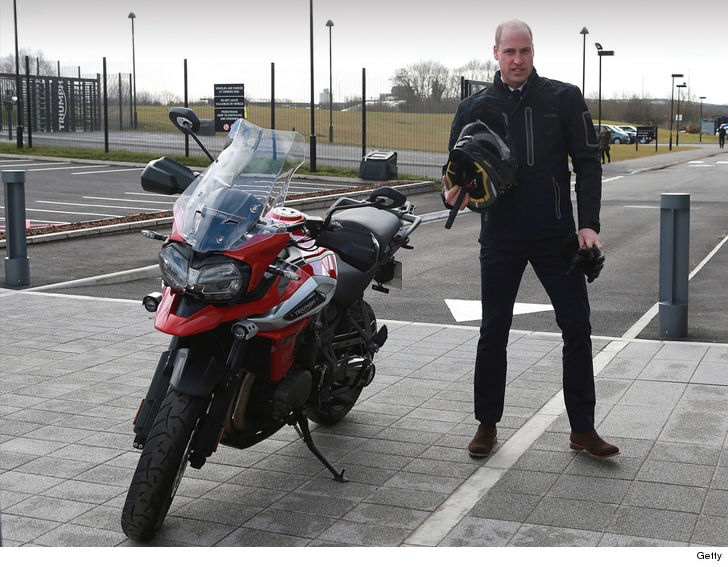 Prince William poses while taking motorbike on a spin