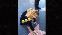 Reese Witherspoon Cleans Her Own Star on the Hollywood Walk of Fame