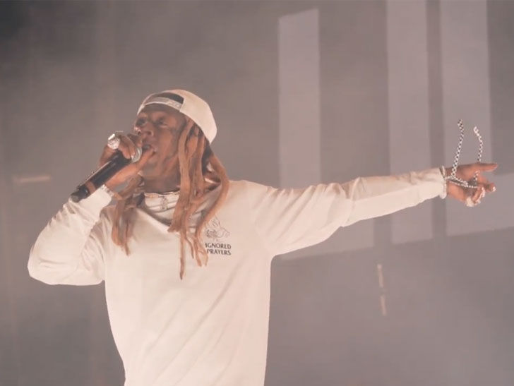 Lil Wayne Threatens Rowdy Concertgoers with Guns
